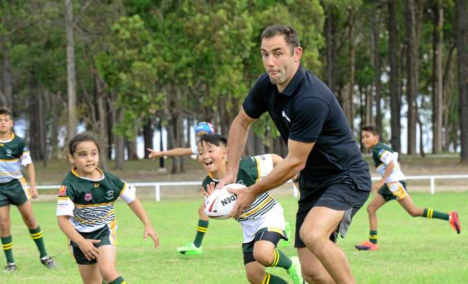 NRL STAR: Cameron Smith puts young players at his junior club Logan Brothers through their paces. Smith said he is looking forward to his testimonial match against friend and North Queensland Cowboys star Johnathan Thurston.