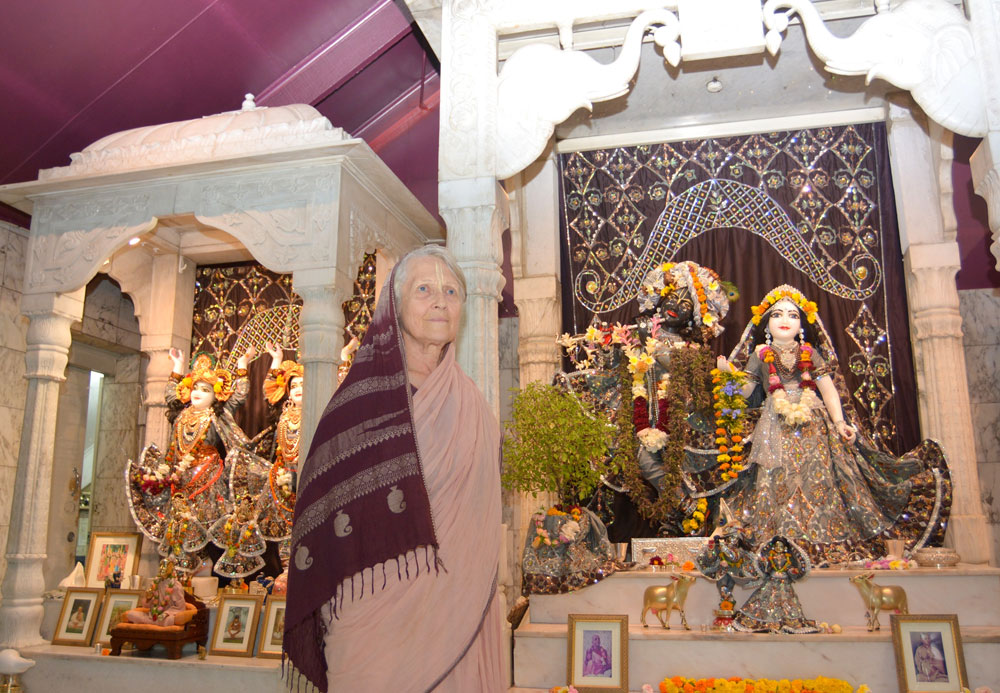 Mandakini Dasi in the temple with the deities she cares for.