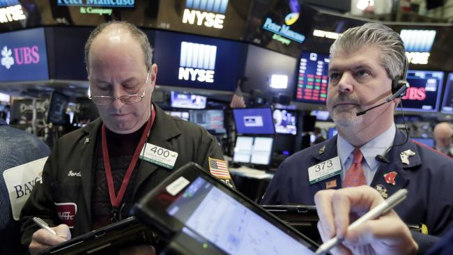 Traders Gordon Charlop, left, and John Panin work on the floor of the New York Stock Exchange, Tuesday 6 February 2018. Picture: Richard Drew/AP