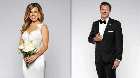 But shock photos reveal Troy was getting cosy with Carly, who married millionaire Justin. Picture: Channel Nine