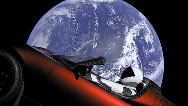 This image from video provided by SpaceX shows the company's spacesuit in Elon Musk's red Tesla sports car which was launched into space during the first test flight of the Falcon Heavy rocket.