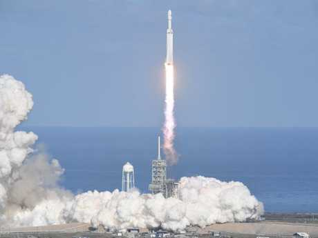 The SpaceX Falcon Heavy takes off from Pad 39A at the Kennedy Space Center in Florida, this morning. Picture: Jim Watson