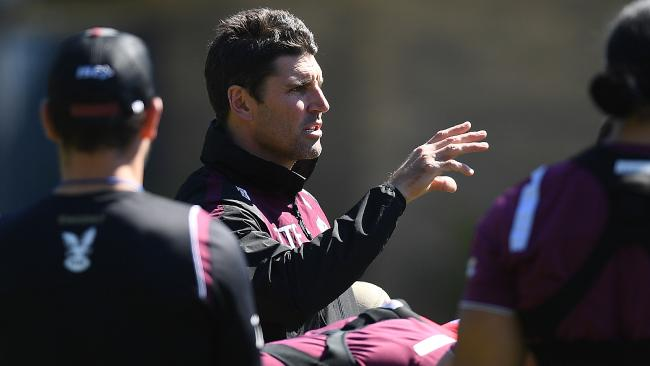 Manly coach Trent Barrett gestures during a team training session.