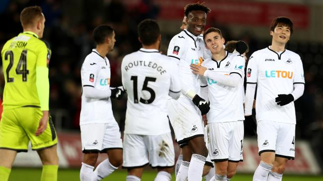 Tom Carroll of Swansea City celebrates.