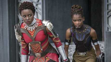 This image released by Disney shows Lupita Nyong'o, left, and Letitia Wright in a scene from Marvel Studios'