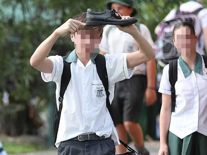 A student at The Gap High accentuates his footwear yesterday. Picture: Peter Wallis