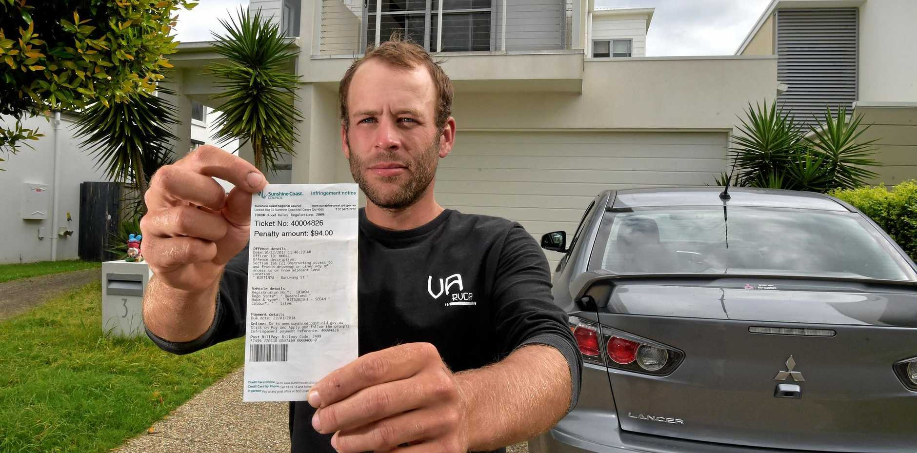 Reese Gerhard was one of several Coast residents caught up in the parking fine blitz. He was fined by the council for parking over the legal boundary of his driveway.