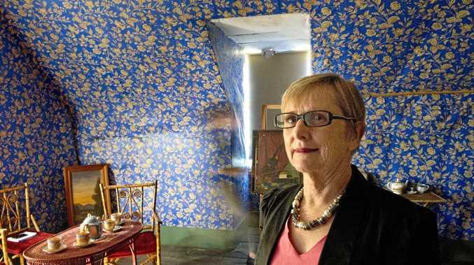 SPOOKY SPIRITS: Helen Moloney checks for ghosts at the Bulls Head Inn.