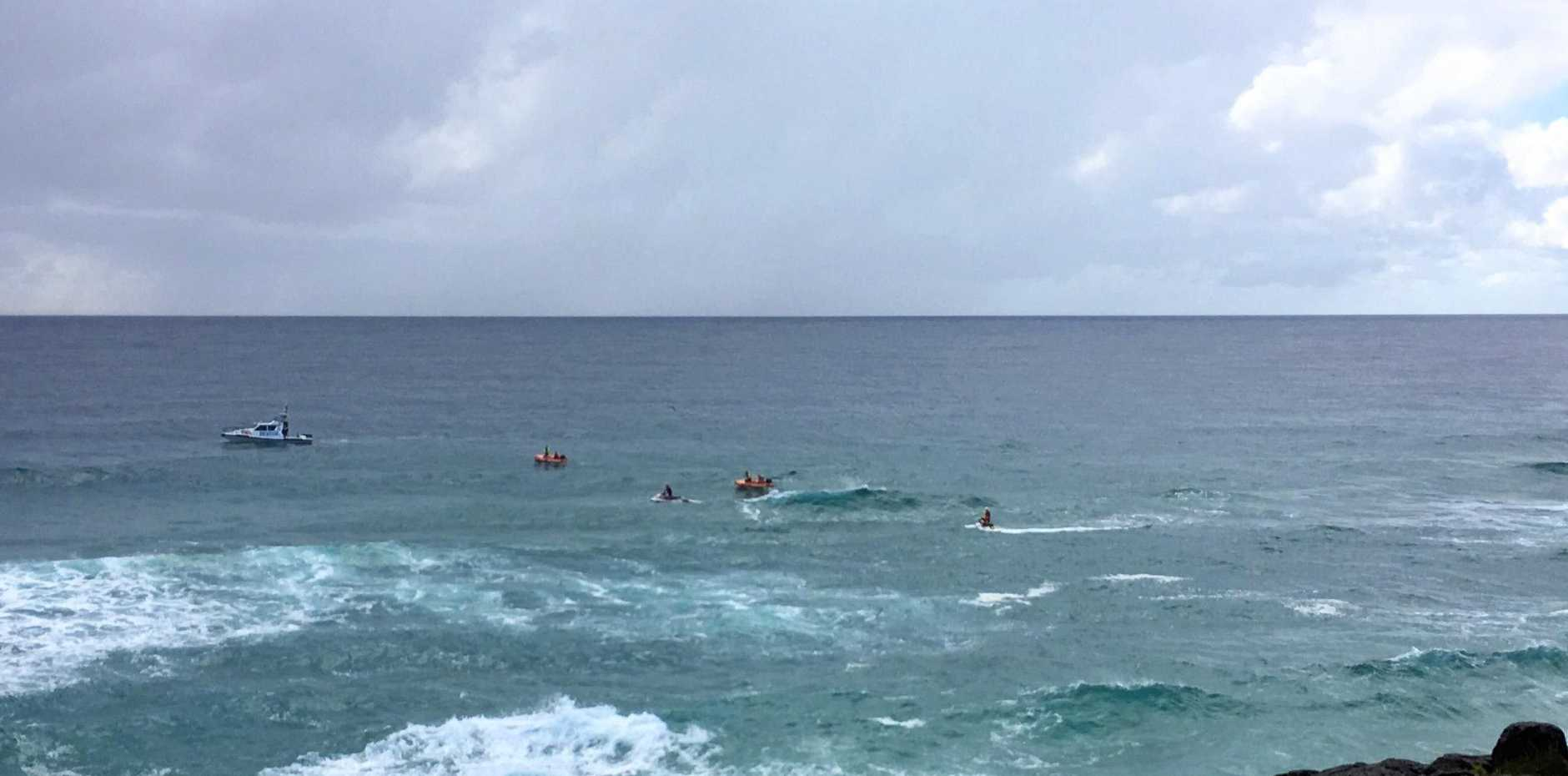 The search for the body of a missing tourist believed to have drowned off Fingal Beach continues this morning in choppy conditions.