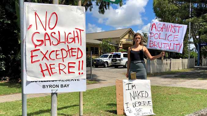 ONE OUT: Lone protester Adaja Black outside Byron Bay Police Station.