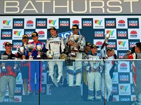Jason Busk enjoys the podium finish with his Taunton team-mates.