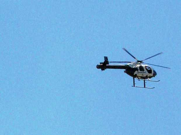 Diana Burgess took this photo of one of the mystery helicopters as it passed over Currimundi today.