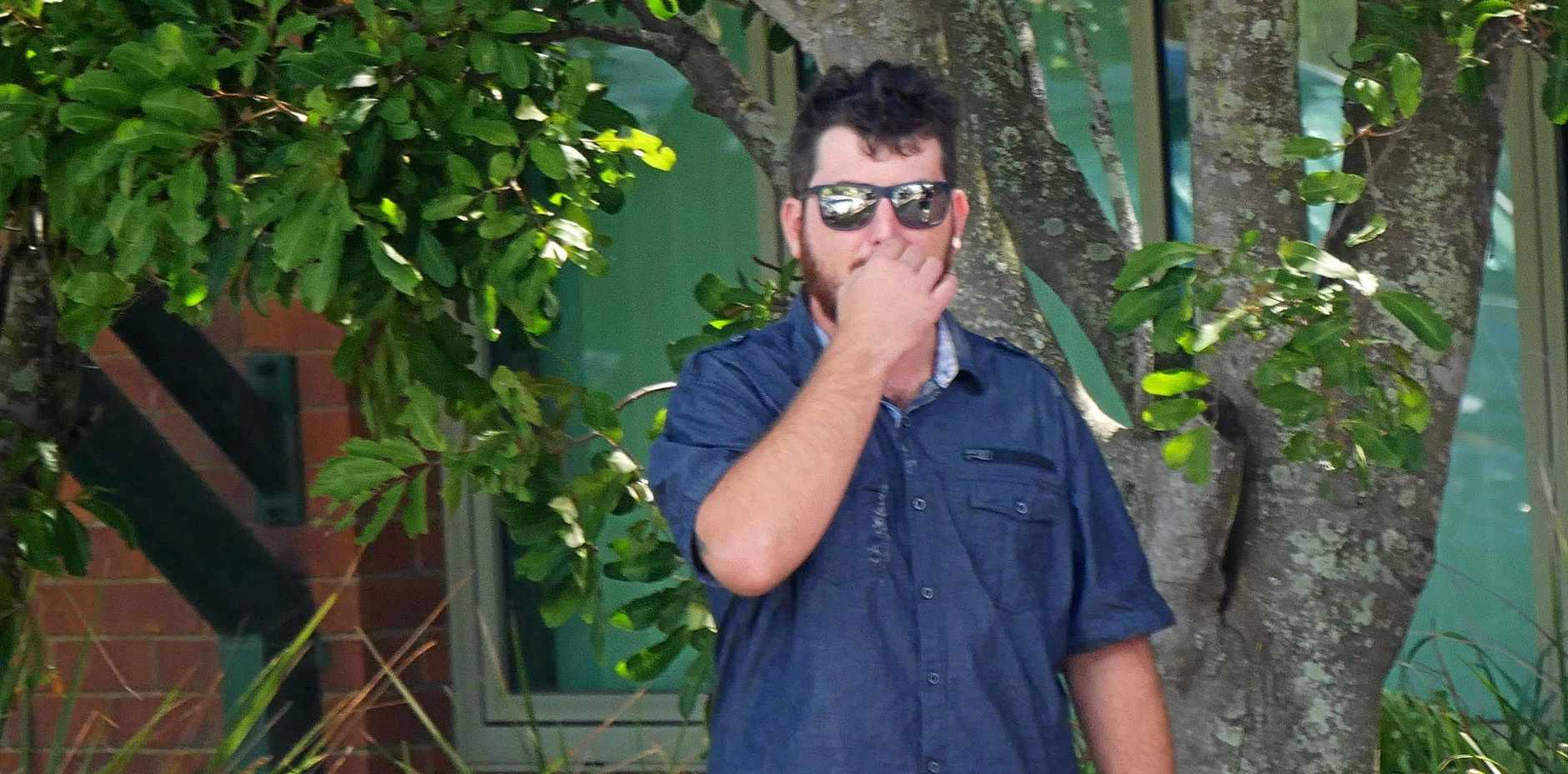 Michael Louis Courtnage, 27, of Burrum Heads, smokes outside Hervey Bay Magistrates Court.
