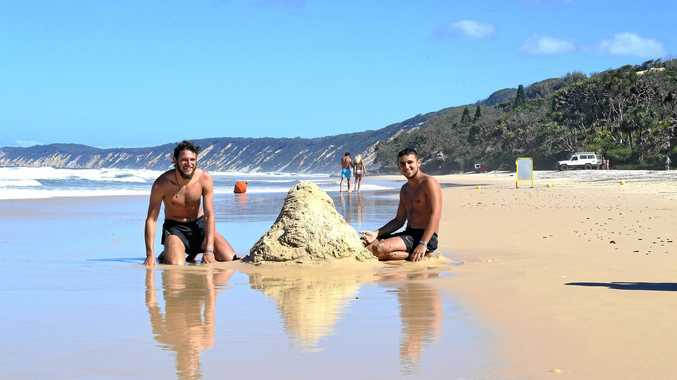NO WORRIES: Tal Sigalov from Israel and Marco Braun from Germany enjoy the Gympie region's stunning Rainbow Beach.