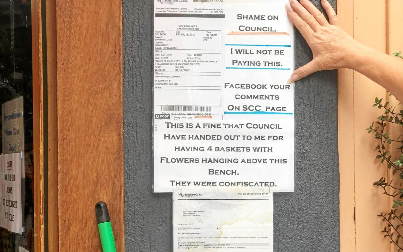 Johanna van Genderen has publicly displayed her defiance of a Sunshine Coast Council fine at the front of her Kenilworth business.