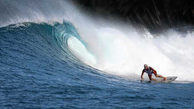 SAFETY FIRST: Surfing paramedic Gavan Clark, 60, can still charge serious waves on his shortboard.