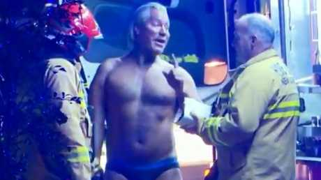 Emergency services question the man. Picture: Nine News