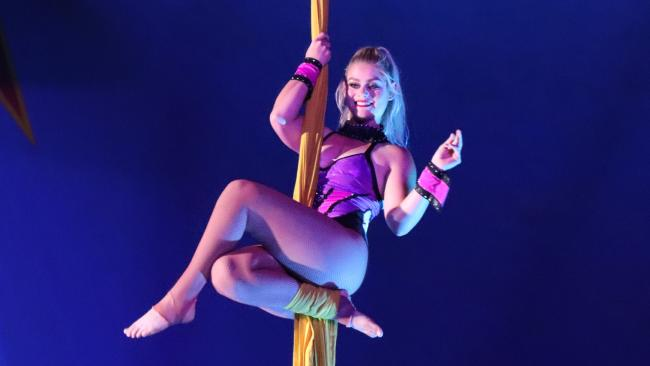 A Stardust Circus performer hangs from the Big Top from silks, in Bathurst NSW, on February 1, 2018.