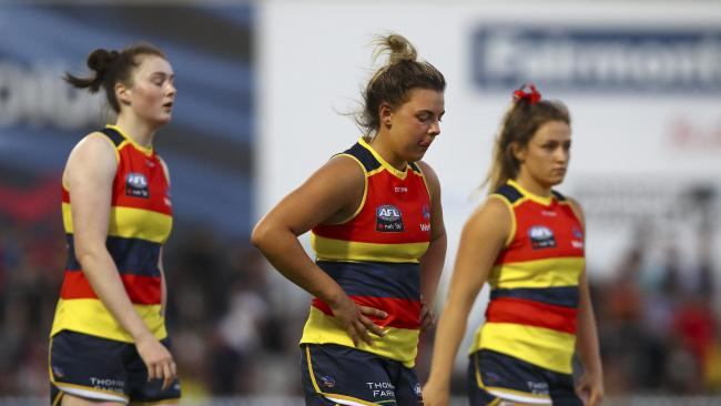 Sarah Allan, Ebony Marinoff and Georgia Bevan after the Crows' loss. Picture Sarah Reed