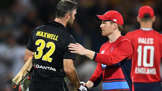 Glenn Maxwell is congratulated by England captain Eoin Morgan after the match. Picture: AFL Photo