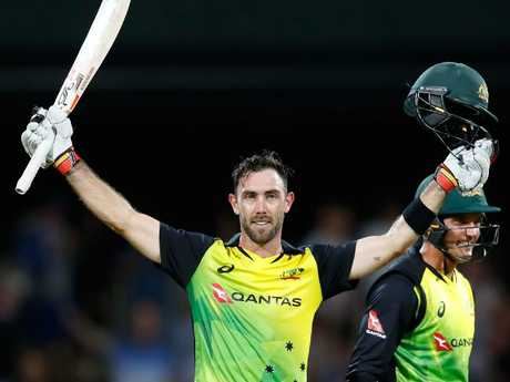 Glenn Maxwell celebrates his century after hitting a six from the last ball.