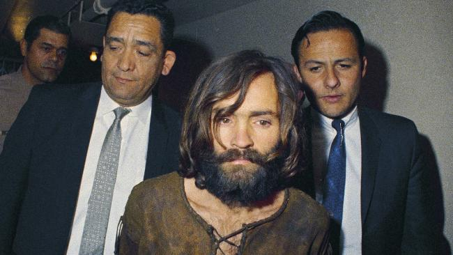 Charles Manson is escorted to his arraignment on conspiracy-murder charges in connection with the Sharon Tate murder case in 1969. Picture: AP Photo