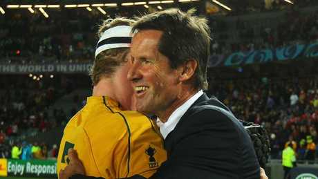Robbie Deans and David Pocock hug one another after the Wallabies' bronze medal win against Wales at the 2011 World Cup.