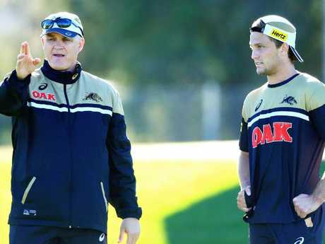 Matt Moylan talks to coach Anthony Griffin during a Panthers training session. Pic Jenny Evans