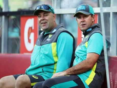 Australian head coach Darren Lehmann (L) talks to assistant Ricky Ponting (R).