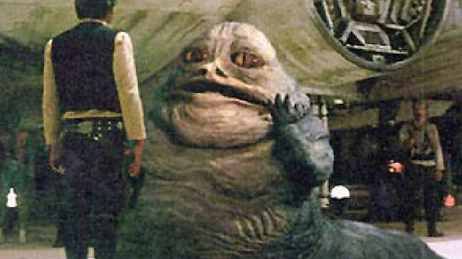 Jabba the Hutt confronts mercenary Han Solo in the special edition of Star Wars: A New Hope.