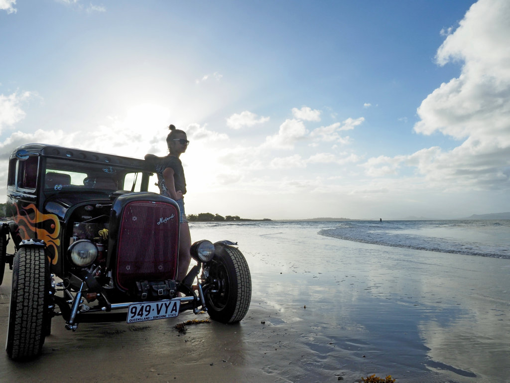 Image for sale: Holly Engelmann with the family hot rod at Shoal Point this week. The beach will be the place to be next week as a heatwave hits the region.