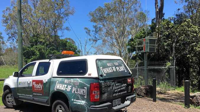 The Fraser Coast Regional Council's Disaster Management Team checks out an automated flood gauge near Owanyilla.