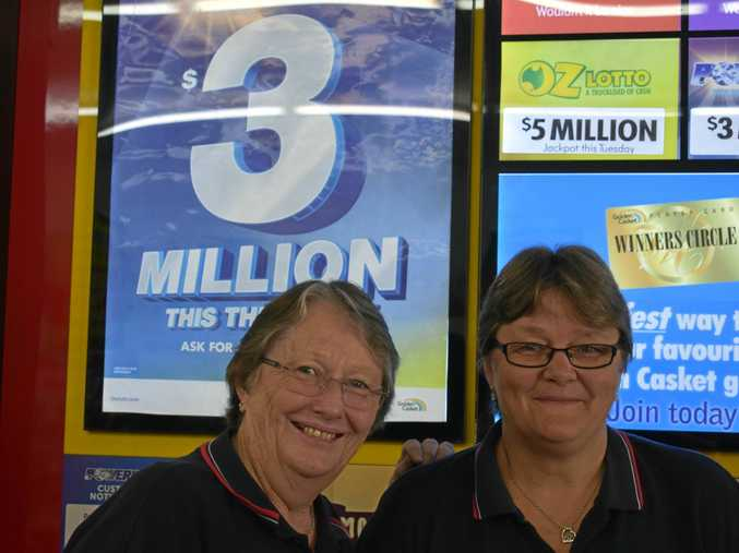 CASHED IN: Paula Troy and Malene Price said they were thrilled a Dalby man came forward to claim his division one victory.