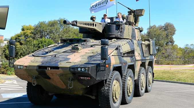 BUILD IT: Ipswich Mayor Andrew Antoniolli and Rheinmetall Defence managing director Gary Stewart get up close with a Boxer CRV in September, 2017.