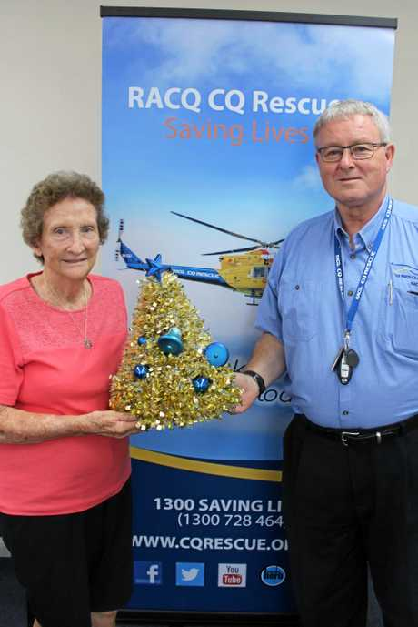 RACQ CQ Rescue CEO Ian Rowan and Midge Point Elf Barbara Butterfield with one of their hand-crafted Christmas trees which they sold to raise $4200 for the regions helicopter.