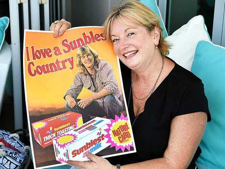 Long time John Farnham fan Suzanne Mackintosh with a poster from over 40 years ago.