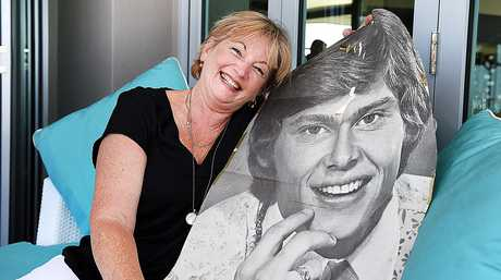 Long time John Farnham fan Suzanne Mackintosh with a poster from 1973 when she saw him at Luna Park.