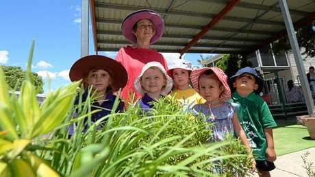 C&K Leichhardt Kindergarten manager Lee McCarthy with some of the children in their garden.