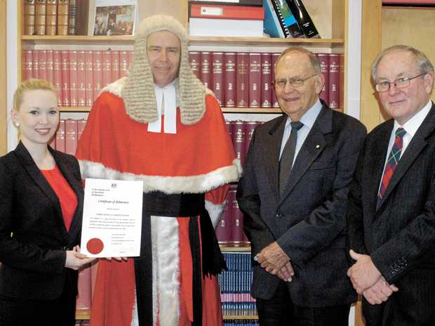 PROUD MOMENT: From left, new solicitor Karen Soanes with Rockhampton Supreme Court Justice Duncan McMeekin, retired Supreme Court Justice Alan Demack and Rockhampton criminal lawyer Doug Winning.  Photo Contributed