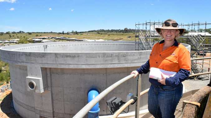 SDRC Water and Wastewater engineering co-ordinator Carmel Kennedy inspect the almost finished clarifer duplication at Glen Rd water treatment plant.
