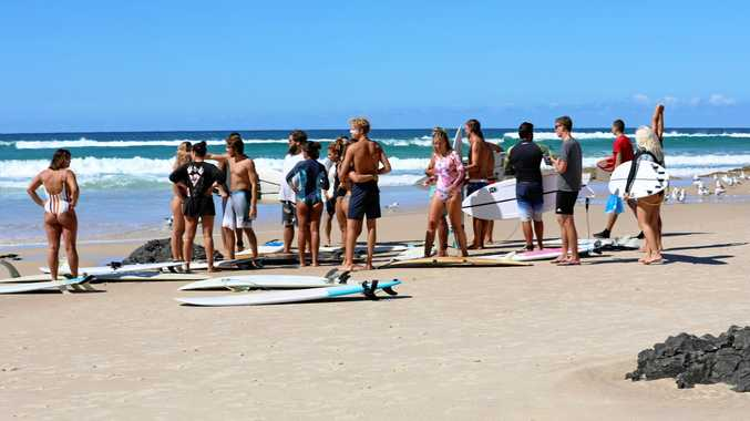 Friends of Tomoe Ogisu, who drowned at Fingal Head on Wednesday afternoon, paddled out at Kirra Beach, where they had regularly gone surfing with Tomoe, on Friday afternoon.