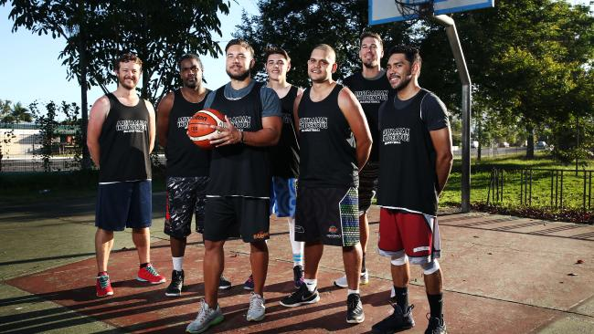 Randy Ware (second from left) with the Black Marlins basketball team ahead of a competition last November. Picture: BRENDAN RADKE