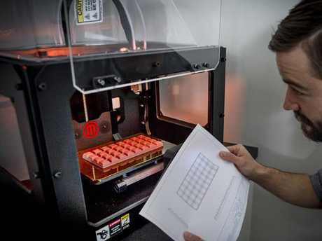 Employee Sam Douglas working with 3D printing to make plastic chocolate bars, all apart of research and development. Picture: Jason Edwards.