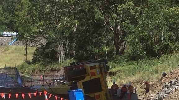 Scene of a crane rollover at the Toowoomba Second Range Crossing off the New England Highway.