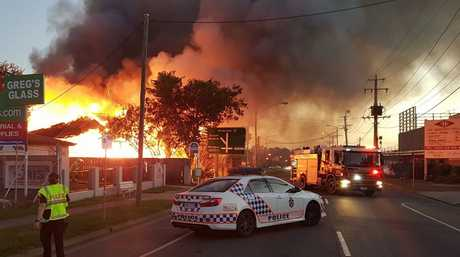 A Queensland Police photo shows the home on Brisbane St in West Ipswich on fire. The fire has been declared suspicious.