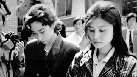 North Korean agent Kim Hyon Hui being escorted into the High Court in Seoul in April 1989.