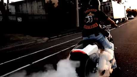The start of the clip shows a Bandido doing a burnout on a suburban street.
