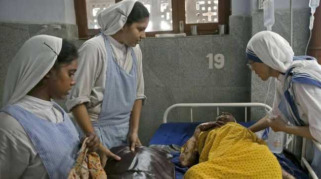 Nuns care for a patient in Kolkata, India. Picture: Getty