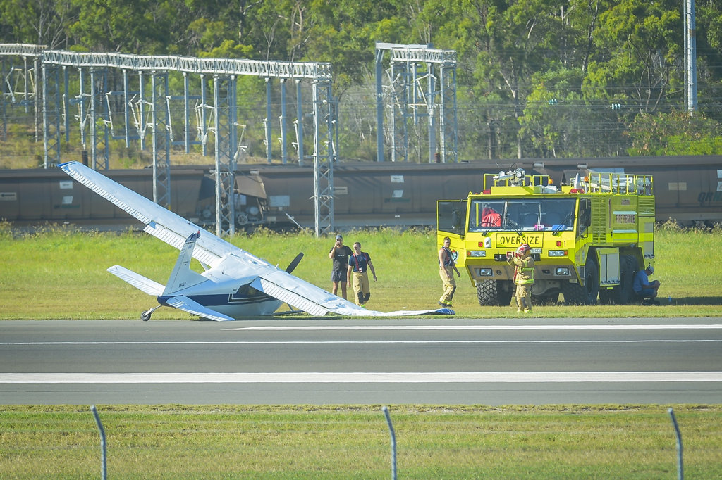 HEAVY DAMAGE: Aviation Fire and Rescue firefighters near the crashed plane.