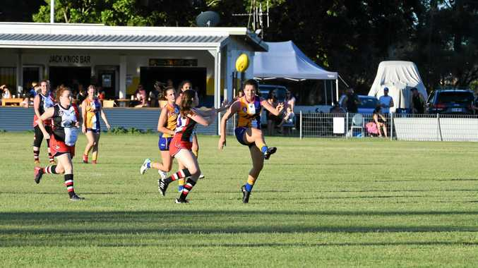 LIFT: The Waves captain Kayla Osborn kicks the ball in AFL Wide Bay women's match against Brothers.